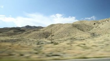 Driving With Distant Mountains — Stock Video