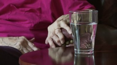 Ice Water and Arthritic Hands — Stock Video