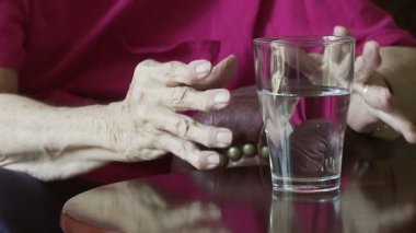 Glass and Arthritic Hands — Vídeo de stock