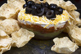 Layered Bean Dip with Chips — Stock Photo