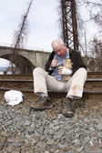 Down and Out Man on Railroad Tracks — Stock Photo
