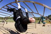 Businessman Upside Down in Playground — Stock Photo