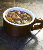 Hearty Lentil, Escarole and Italian Sausage Soup — Stock Photo