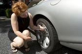 Woman Checking Tire Pressure — Stock Photo