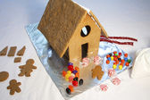 Decorating a Gingerbread House — Stock Photo