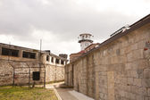 Prison Yard and Guard Tower — Stock Photo
