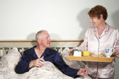 Couple with Breakfast in Bed — Stock Photo