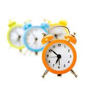 Four colorful alarm clocks — Stock Photo