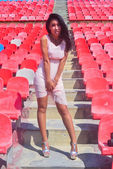 Asian Model Posing at the stadium standing on the bright seats — Stock Photo