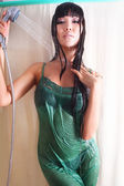 Beautiful Model in a green dress in the shower under running water — 图库照片
