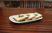 Piquant sandwich with cheese and fennel on the plate — Stock Photo