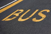 Bus written on asphalt — Foto de Stock