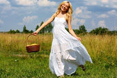 The girl in the field with a basket of fruit — Stock Photo