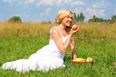 Very beautiful girl with a basket of fruit — Stock Photo