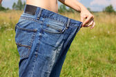 Girl holds hands wide jeans — Foto Stock