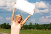 Girl with the poster — Stock Photo