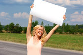 Beautiful girl with a poster — Stock Photo