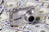 Camera on the dollars — Stock Photo