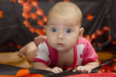 Cute baby crawling over bed — Stock Photo
