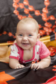 Baby on bed — Stock Photo