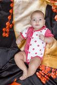 Baby lies on bedding — Stock Photo