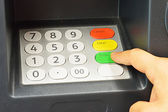 Close-up of hand withdraw on ATM bank machine keypad — Stock Photo