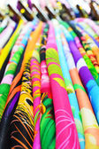 Stack of colourful folded fabric for use in sewing clothing — Stockfoto