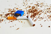 Broken cigarettes with a brown filter close up  — Stock Photo
