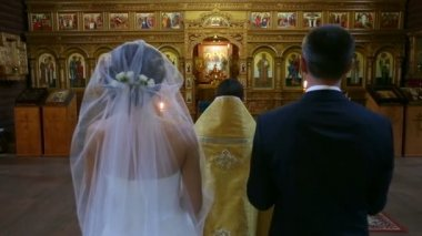 The bride and groom in the church — Stock Video