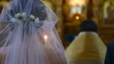 Bride with the groom in the church — Stock Video