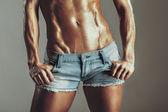 Abdomen muscled girls in shorts — Stok fotoğraf