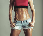 Abdomen muscled girls in shorts — Stock Photo