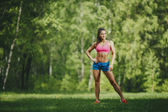 Fitness woman runner in park before running work out — Stock Photo