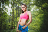 Portrait sport young beautiful woman in fitness wear, outdoors — Stock Photo