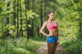 Fitness woman runner relaxing after running — Stock Photo