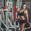 Sexy girl with dumbbells in the gym — Stock Photo #51550959