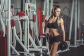 Sexy girl with dumbbells in the gym — Stock Photo