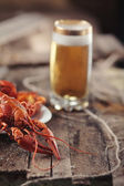 Crayfish with a glass of beer in a tree vintage — Stock Photo