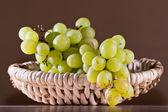 Green grape on basket — Stock Photo