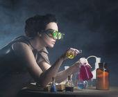 Alchemist girl alchemist girl with test tubes in hand — Stock Photo