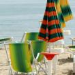Line of sun beds and parasols — Stock Photo #51375999
