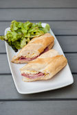 Ham & Brie Sandwich served with salad — Stock Photo