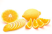Mandarin, orange and red grapefruit sliced isolated on a white background — Стоковое фото
