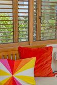 Bedroom interior. Colorful pillows. Wooden windows — Foto de Stock