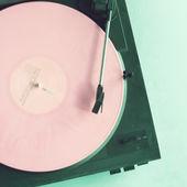 Retro turntable with pink vinyl — Stock Photo