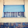Window with blue roller shutter — Stock Photo #50550451