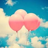 Rosa ballons am himmel — Stockfoto
