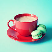 Cup of tea or coffee and macaroons — Stock Photo