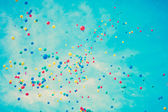 Colored balloons in flight — Stock Photo