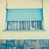 Window with blue roller shutter — Stock Photo